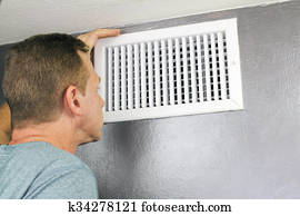 Inspecting a Home Air Vent for Maintenance
