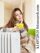 woman near warm radiator