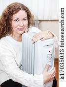 Woman embracing radiator
