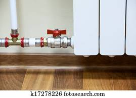 Pipelines with shutt of valve with white central heating radiator