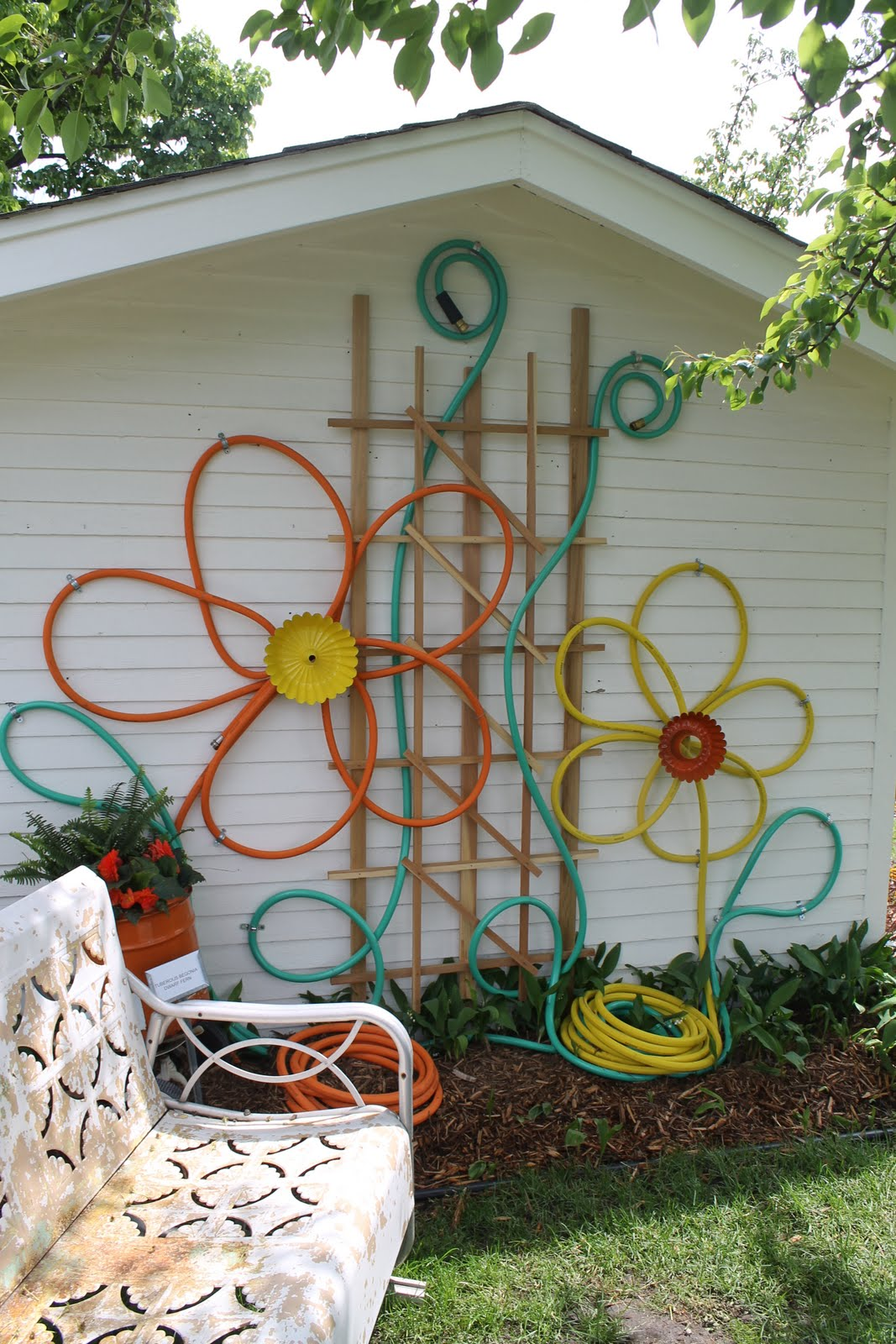 Make flowers from hoses for outdoor house decor
