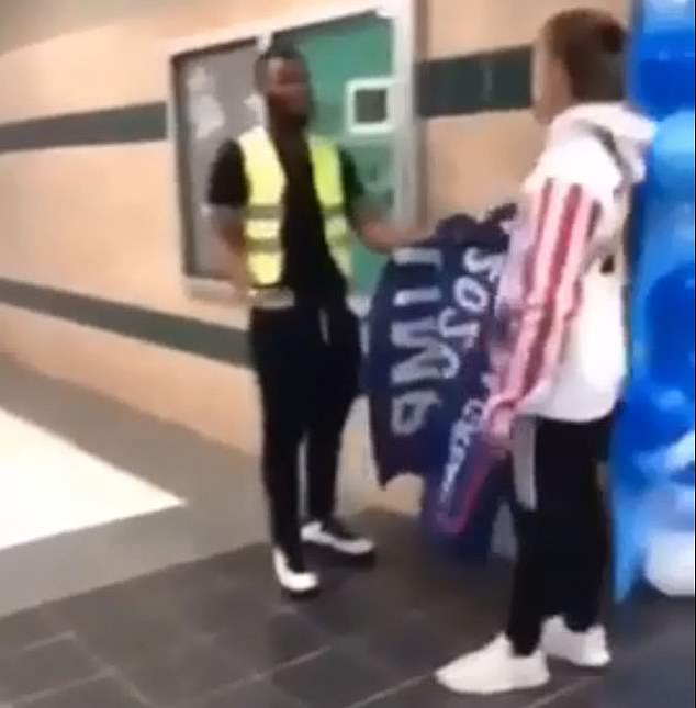 The video then shows the 18-year-old ripping the flag out of the student