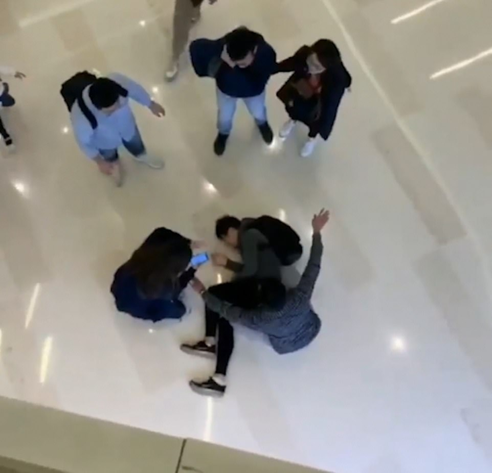 After leaping over the second floor of the mall the protester was taken away by paramedics, Radio Television Hong Kong reports
