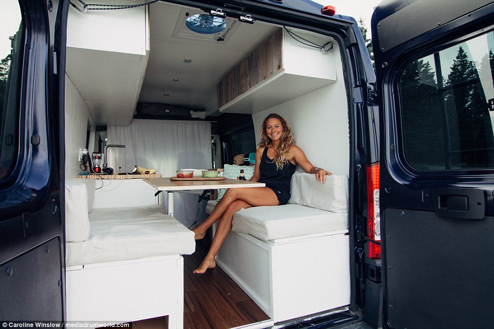 Cosy: Inspired by a summer living off-grid with her boyfriend, an environmental policy student decided to convert her van into a living space to reduce her carbon footprint. Caroline Winslow, 22, from Colorado, spent a summer modifying her Ram Promaster, at a cost of around $7,000 which is the amount she receives from her school as an off-campus living stipend