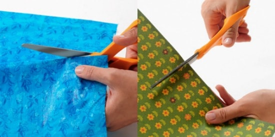 Cutting a piece of fabric or paper with scissors
