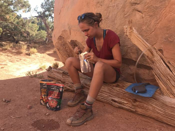 eating Omeals backpacking meals in Canyonlands